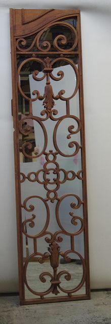 Custom mirror made from a salvaged wrought iron gate from Argentina #diy #antiquegate