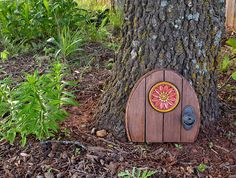 This magical DIY will show you how to make a gnome door! Such a sweet addition to any garden!