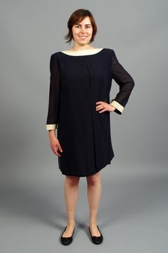($54.00) This chic vintage dress is perfect for your next cocktail party! This high-quality, designer dress features a chic mod design with sheer sleeves and a sheer overlay in navy blue with beige trim. This dress also has a zipper in the back. This dress was made in Switzerland by Akris. This dress is in excellent, like-new vintage condition.  This dress fits a women's large best, but because of the dress design it can be worn by many sizes.  Measurements: Bust- 40in max Waist- Free Hip…