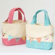 This gorgeous wee toddler tote bag is decorated with rows of multi coloured bunting on either side.  Made from medium weight calico and two tone blue cotton fabric. Fully lined in a light weight calico and interfaced for structure. The handles have bee...