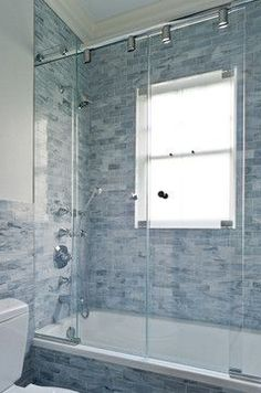 Hate having windows in the shower, but this is a good cover up and makes the outside look just like a window while providing privacy.  Pelham Shingle Style for a Modern Family - contemporary - bathroom - new york - Fivecat Studio | Architecture
