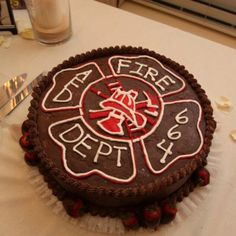 Fireman grooms cake with fondant accents