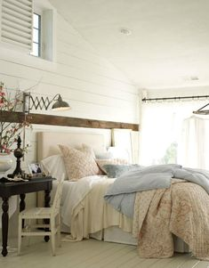plank walls in bedroom - photo by anna williams - desire to inspire - via Talk of the House... cozy bed.  desk next to bed idea for me