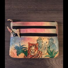 Emily Ann Boca Raton Hand Painted Leather Pouch Main zip closure.  2 front. Zip pockets.  Good condition with light wear on corners.  Measures: 6.75x5.25. Emily Ann Bags Wallets