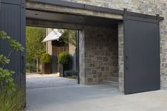 Overhead barn doors and old stone   | Usual House