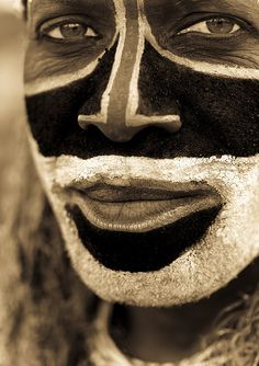Eyes peering out from ceremonial makeup in Papua, New Guinea.