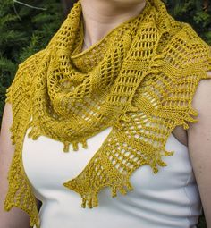 Free Knitting Pattern for Baskin Shawl - This crescent shaped lace shawlette features a triple picot bind off. It's knit with a single skein of the recommended yarn. Designed by Rhiannon McCulloch