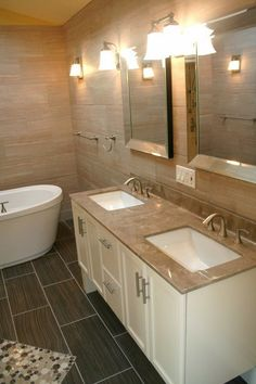 modern bathroom cultured marble countertops white vanity wall mirrors wall sconces
