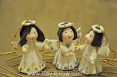 cute angel figurines made of soft clay or fondant for Christmas tree decoration or Christmas cake decoration