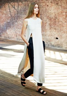 Sleeveless top with slits that extend above the waistline with black cropped trousers at The Row's S/S 15 runway