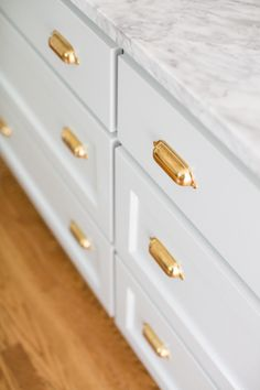 Gorgeous kitchen hardware: http://www.stylemepretty.com/living/2016/01/14/spotted-hardware-revamp/