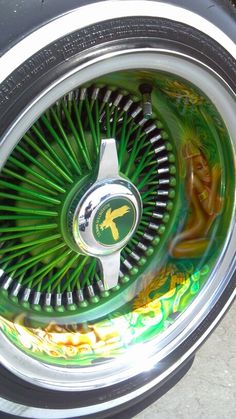 Aztec airbrush art on lowrider wire rims