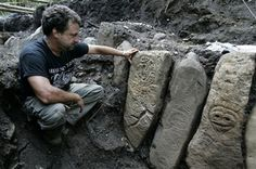 Major archaeological find in Puerto Rico: Puerto Rican archaeologist Hernan Bustelo sits next stones etched with ancient petroglyphs.