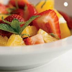 Orange strawberry fruit salad with brown sugar-mint dressing. So easy! via farmflavor.com