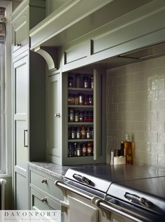 The mantle surround has a spice cupboard integrated within it. This clever use of space optimises every inch of potential storage as well as keeping these cooking essentials within easy reach when cooking on the range.