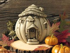 This cute pumpkin house can be the latest addition to your fairy garden collection with its fine details and imaginative look. The Pumpkin Palace Statue has a charming thatched roof and curling pumpkin vines as decoration. Clay Fairy House, Fairy Houses, Garden Houses, Gnome House, Polymer Clay Fairy, Polymer Clay Crafts, Ceramics Projects, Clay Projects, Clay Houses
