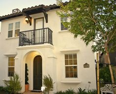This was a remodel on an eco-friendily home in a LEED neighborhood that was landscaped with low water use plants, flagstone paths, trellises covered in bougainvillea and a gorgeous patio with a handcrafted lattice wall - also added a custom Spanish 3-tier wall fountain! www.homescapes-sd.com