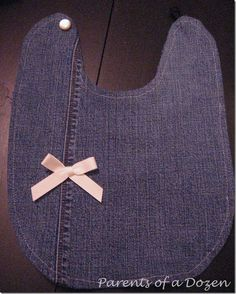 Denim jean baby bibs. I LOVE this idea of using an elastic hair band for the button! Masterful!