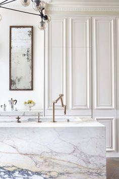 Marble Island | brass faucet | door to ceiling cupboards