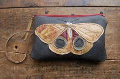golden io moth on crackly black repurposed leather mini clutch