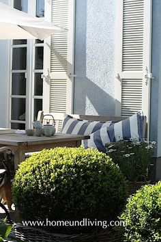 Home  Living, like the relaxed style and the shutters on house.