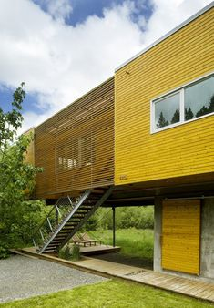 Modern home with Exterior, House, Wood Siding Material, and Flat RoofLine. Photo 3 of Neal Creek