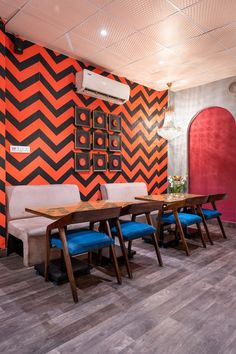 The eclectic style décor for the cafe is all about creating harmony and coming together of disparate styles to innovate cohesive experimentation and play. Pink Ceiling, Wooden Textures, Comfortable Sofa, Reception Table, Mosaic Patterns, Eclectic Style, Wooden Flooring, Wooden Tables, Design Firms