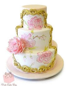 Baroque Painted Floral Wedding Cake.  The cake is partially covered in peachy fondant in the back with a gold dusted frame revealing a beautiful painted floral motif of peonies against white fondant.  Design from Nadia & Co-Boucher