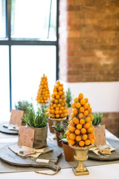 kumquat topiary centerpieces in metallic urns Topiary Centerpieces, Wedding Centerpieces, Wedding Decorations, Fruit Wedding, Wedding Orange, Wedding Colors, Mesas Para Baby Shower, Mediterranean Wedding, Fruit Decorations