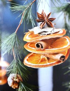 natural rustic xmas decoration made with dried orange pieces, cinnamon, clove & bay leaf