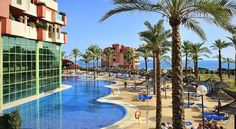 Holiday Palace Benalmádena Holiday Palace is located between Benalmádena and Fuengirola, 500 metres from the beach. This hotel features an outdoor swimming pool, spa and suites with kitchenettes and balconies.