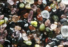 Sand grains Lake Winnibigoshish, Minnesota. Contains igneous and metamorphic minerals of the Lake Superior basin.