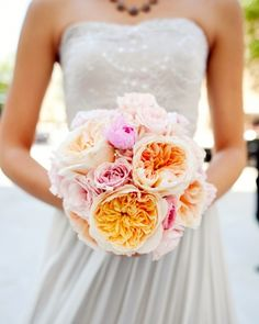here is an example of garden roses  Rose Bouquet  These bridesmaids carried pink and peach garden roses.