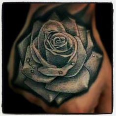Blue rose hand tattoo by Lalo Pena.