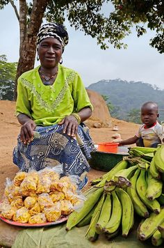 Aloco (banana chips) seller, Conakry, Guinea.