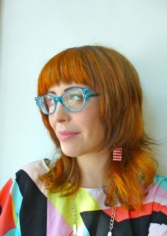 Fiery orange chunky highlights and a rocker-chic cut for Krista.