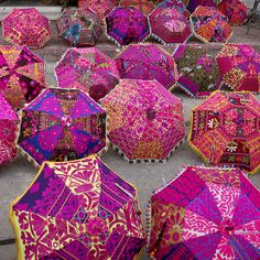 I love colorful Indian Parasols  Note: Again, I can imagine an array of these at a Bazaar!