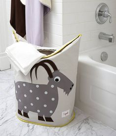 children's laundry hamper by nubie modern kids boutique | notonthehighstreet.com This site has some amazing baby things!!