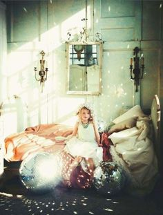 child fairy aside, i would not mind a combo of whitewashed furniture and disco balls in my own house