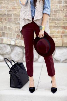 Shop this look on Lookastic: http://lookastic.com/women/looks/denim-shirt-vest-skinny-pants-tote-bag-hat-pumps/913 — Blue Denim Shirt — Grey Knit Vest — Burgundy Skinny Pants — Black Leather Tote Bag — Burgundy Wool Hat — Black Suede Pumps