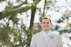 Beach wedding groom outfit idea - tan tuxedo with starfish boutonniere  {Off BEET Productions}