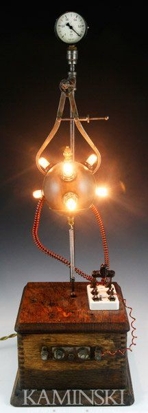 "Chris Osborne (American b.1950), assemblage lamp #20 ""Caliper"", sculptural steampunk lamp composed of antique lamp parts, industrial and found objects"