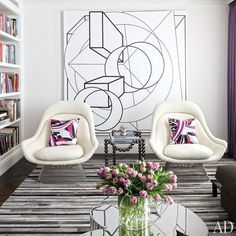 Interior designer Delphine Krakoff renovates a Manhattan residence, crafting a luxurious setting for the owners' array of contemporary art | Living room: A painting by Al Held is displayed behind a pair of Warren Platner chairs by Knoll | [AD]