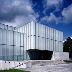 London firm Terry Pawson Architects have completed a new gallery and theatre in Carlow, Ireland, which opened on Saturday. The building, called VISUAL & the George Bernard Shaw Theatre, features a façade made of large panels of opaque glass on a concrete plinth. The interior has a large gallery at its centre with smaller gallery