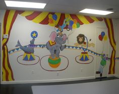 Daycare Circus Mural D Daycare. Elephant on a ball, clown, lion jumping through hoop, seal with a ball, clown juggling, circus tent