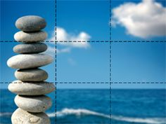 This photo follows the rule of thirds because it of centers the rocks
