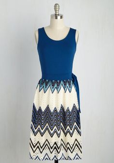 You cherish moments spent with a tranquil attitude, which is where this twofer dress takes you with every wear. Creating an ensemble environment of comfort with a soothing cobalt bodice and a crocheted skirt in ivory, black, and touches of teal, this A-line is symbolic of stylish peace.