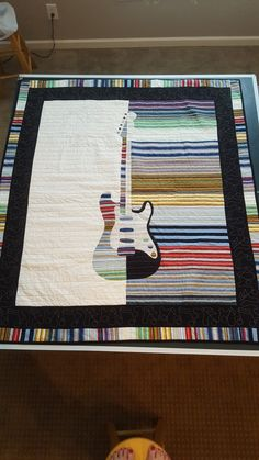 Couldn't find a guitar quilt I wanted to make, so I designed one!