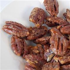 Nov 23 Pecans are baked in a sweet cinnamon coating creating tasty candied pecans perfect for holiday gifts. Candied Pecans Recipe, Glazed Pecans, Sugared Pecans, Roasted Pecans, Candied Nuts, Pecan Desserts, Pecan Recipes, Delicious Desserts, Cooking Recipes