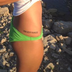 Cute tattoo placement. Maybe a birthday in Roman numerals?